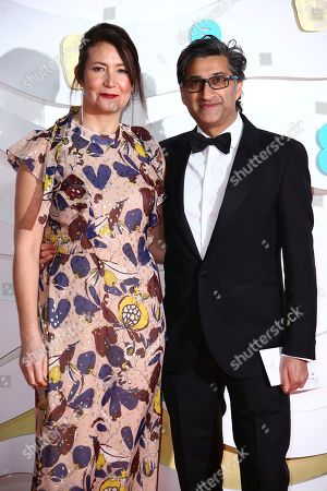 Stock Picture of Asif Kapadia, Victoria Harwood. Asif Kapadia, right and Victoria Harwood pose for photographers upon arrival at the Bafta Film Awards, in central London