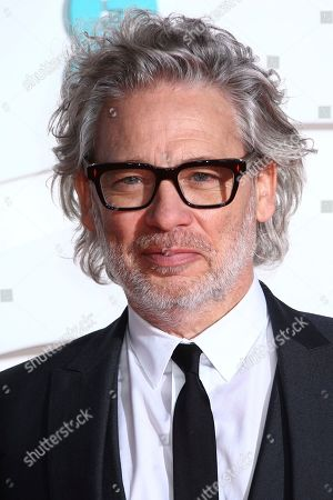 Dexter Fletcher poses for photographers upon arrival at the Bafta Film Awards, in central London