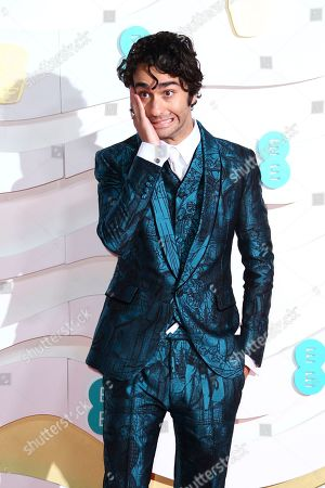 Alex Wolff poses for photographers upon arrival at the Bafta Film Awards, in central London