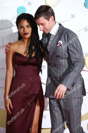 Zazie Beetz, David Rysdahl. Actress Zazie Beetz, right, David Rysdahl pose for photographers upon arrival at the Bafta Film Awards, in central London