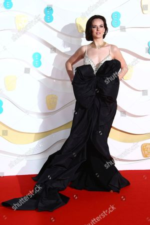 Charlotte Carroll poses for photographers upon arrival at the Bafta Film Awards, in central London
