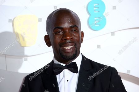 Jimmy Akingbola poses for photographers upon arrival at the Bafta Film Awards, in central London