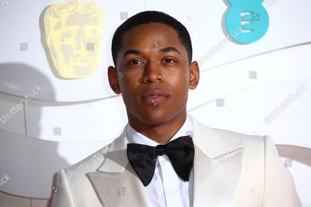 Kelvin Harrison Jr. poses for photographers upon arrival at the Bafta Film Awards, in central London