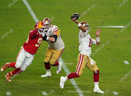 San Francisco 49ers quarterback Jimmy Garoppolo  (10) under pressure from Kansas City Chiefs outside linebacker Terrell Suggs  (94).