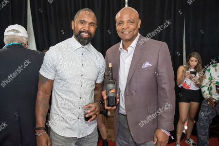 Charles Woodson, Warren Moon. From left, Hall of fame NFL players Charles Woodson and Warren Moon pose with Woodson's new wine, Intercept, at the Players Tailgate at Super Bowl LIV, in Miami