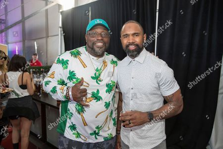 Stock Image of Warren Sapp, Charles Woodson. From left, Hall of fame NFL players Warren Sapp and Charles Woodson pose at the Players Tailgate at Super Bowl LIV, in Miami