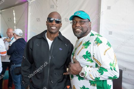 Chad Johnson, Warren Sapp. From left, Ex-NFL players Chad Johnson, and Warren Sapp, pose at the Players Tailgate at Super Bowl LIV, in Miami