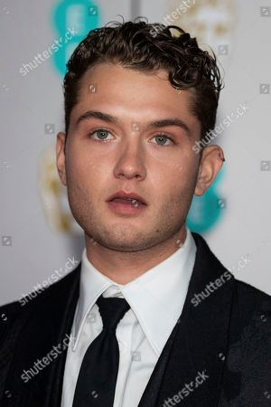 Rafferty Law poses for photographers upon arrival at the Bafta Film Awards, in central London