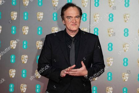 Quentin Tarantino poses for photographers upon arrival at the Bafta Film Awards, in central London