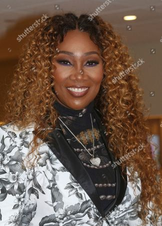 """Grammy-winning recording artist Yolanda Adams poses for a photograph before the start of of the NFL Super Bowl 54 football game in Miami Gardens, Fla., . Adams sang """"America the Beautiful"""" before the game"""