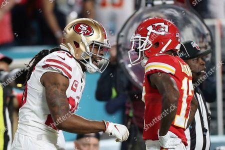 Richard Sherman;Mecole Hardman. San Francisco 49ers cornerback Richard Sherman (25) reacts after Kansas City Chiefs wide receiver Mecole Hardman (17) caught a pass in Super Bowl 54, in Miami Gardens, Fla
