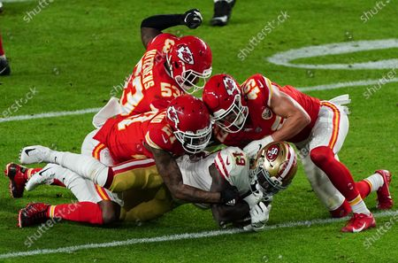 Deebo Samuel Wide Receiver of the San Francisco 49ers (19) is tacked by Bashaud Breeland Cornerback of the Kansas City Chiefs (21) and Daniel Sorensen Safety of the Kansas City Chiefs (49). Super Bowl LIV, Hard Rock Stadium, Miami, Florida. 2nd February 2020. Picture: Dave Shopland/NFL UK