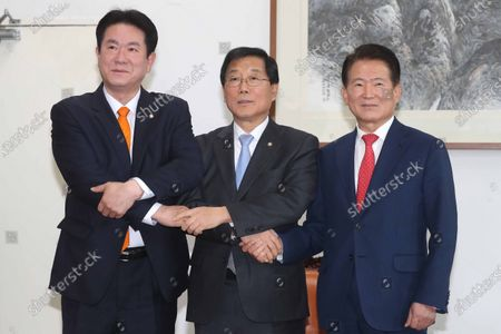 The vice floor leaders of the South Korea's three major political parties, Yoon Hu-duk (C) of the ruling Democratic Party, Kim Han-pyo (R) of the main opposition Liberty Korea Party and Lee Dong-sup (L) of the minor opposition Bareunmirae Party, pose for a photo ahead of their meeting to reach a deal on a schedule for an extraordinary session, at the National Assembly in Seoul, South Korea, 03 February 2020.