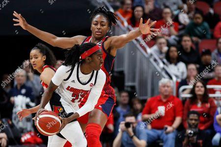 USA Women's National Team forward Nneka Ogwumike (16) defends against Louisville guard Jazmine Jones (23) during an NCAA women's exhibition basketball game, in Louisville, Ky