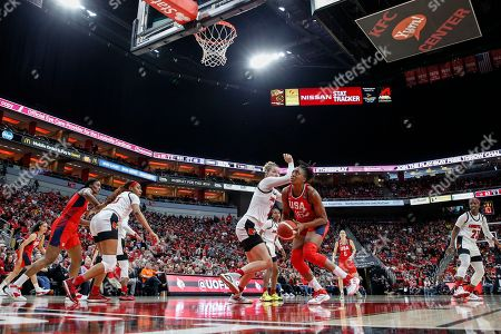 USA Women's National Team forward Nneka Ogwumike (16) drives for a shot past Louisville forward Kylee Shook (21) during an NCAA women's exhibition basketball game, in Louisville, Ky
