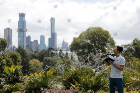 Serbia's Novak Djokovic poses with his trophy, the Norman Brookes Challenge Cup, during a photo shoot at Melbourne's Royal Botanic Gardens following his win over Austria's Dominic Thiem in the men's singles final of the Australian Open tennis championship in Melbourne, Australia