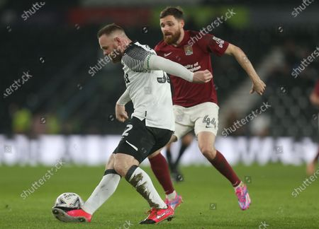 Derby County's Wayne Rooney battles with Northampton Town's Paul Anderson
