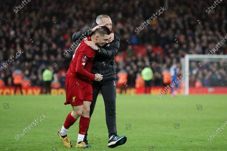 Stock Image of Liverpool Under 23 manager Neil Critchley and Adam Lewis celebrate after the full time whistle