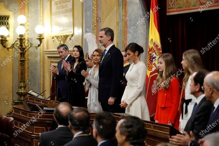 Stock Image of Speaker of Spanish Lower House Meritxel Batet (3L), and Speaker of the Senate Pilar Llop (2L), applaud as King Felipe VI of Spain chairs the State Opening of Parliament next to Queen Letizia (C-R), Crown Princess Leonor (2R) and Infanta Sofia (R) during the State Opening of Parliament at the Lower House in Madrid, Spain, 03 February 2020. The ceremony is chaired by the Spanish King.