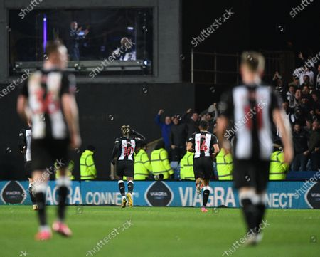 4th February 2020; Kassam Stadium, Oxford, Oxfordshire, England; English FA Cup Football; Oxford United versus Newcastle United; Allan Saint-Maximin of Newcastle celebrates scoring in front of the away fans and Alan Shearer in the commentary box in 26th minute of extra time 2-3