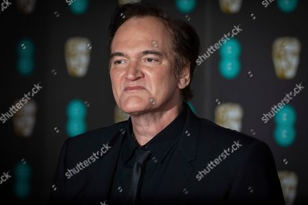 Quentin Tarantino poses for photographers upon arrival at the BAFTA awards in London