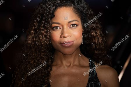 Naomi Harris poses for photographers upon arrival at the BAFTA awards in London