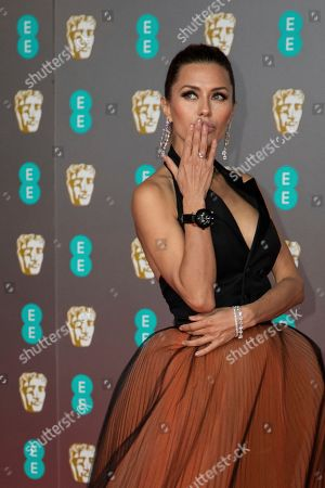 Victoria Bonya poses for photographers upon arrival at the Bafta Film Awards, in central London