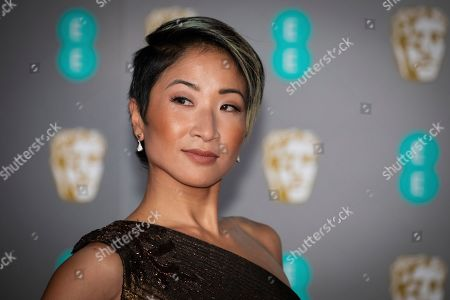 Kae Alexander poses for photographers upon arrival at the Bafta Film Awards, in central London