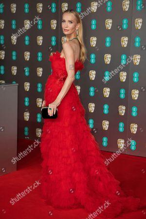 Tatiana Korsakova poses for photographers upon arrival at the Bafta Film Awards, in central London