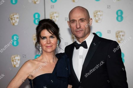 Liza Marshall, Mark Strong. Liza Marshall and Mark Strong pose for photographers upon arrival at the Bafta Film Awards, in central London