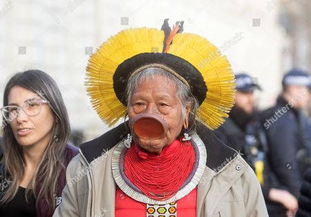 Raoni Metuktire wearing a lip disc arrives to deliver a petition to Downing Street
