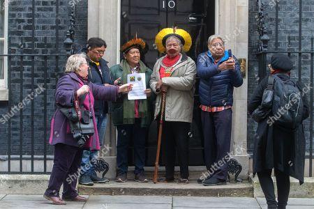 Indigenous Leader L-R, Megaron Txucarramãe, Kayapo leader, Davi Kopenawa Yanomami, Raoni Metuktire, Beprô Metuktire from Brazil deliver a petition to Downing Street