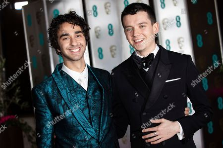 Alex Wolff, Asa Butterfield. Alex Wolff and Asa Butterfield pose for photographers upon arrival at the BAFTA Film Awards after party in London