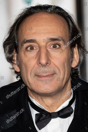 Alexandre Desplat poses for photographers upon arrival at the BAFTA Film Awards after party in London