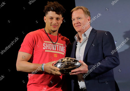 Kansas City Chiefs quarterback Patrick Mahomes, left, holds the MVP trophy with NFL Commissioner Roger Goodell before speaking at a news conference, in Miami