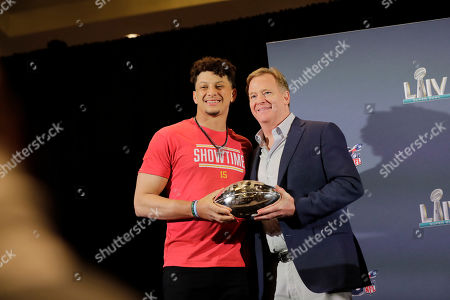 Kansas City Chiefs quarterback Patrick Mahomes, left, holds the MVP trophy with NFL Commissioner Roger Goodell, before speaking at a news conference, in Miami