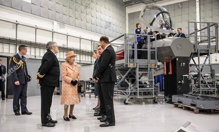 Stock Picture of Queen Elizabeth II is greeted by Personnel at RAF Marham where she inspected the new integrated training centre that trains personnel on the maintenance of the new RAF F-35B Lightning II strike aircraft. With her is Station commander Group captain James Beck.