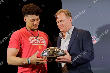 Kansas City Chiefs quarterback Patrick Mahomes (15) holds the MVP trophy with Commissioner of the NFL Roger Goodell, before Mahomes speaks during a news conference, in Miami after winning the NFL Super Bowl 54 football game