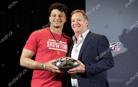 Kansas City Chiefs quarterback Patrick Mahomes (L) accepts the Super Bowl MVP Trophy from NFL Commissioner Roger Goodell (R) during a press conference for National Football League Super Bowl LIV in Miami, Florida, USA, 03 February 2020. The Kansas City Chiefs won the National Football League Super Bowl LIV against the San Francisco 49ers on 02 February 2020.