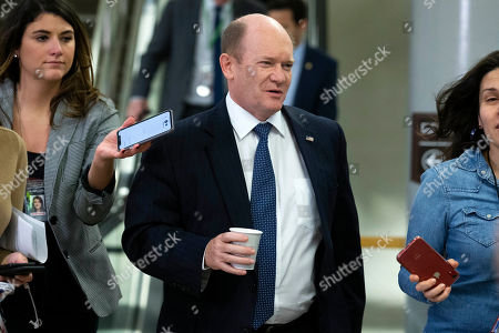 Stock Picture of Sen. Christopher A. Coons, D-Del., talks to reporters as he walks on Capitol Hill in Washington