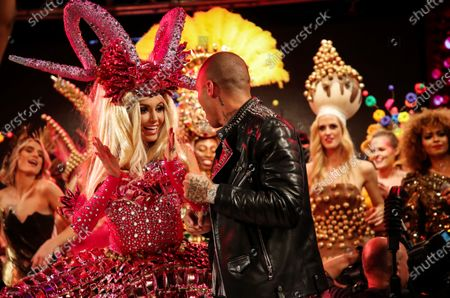 Stock Picture of The Irish actress, model and former Miss World 2003, Rosanna Davison (L) and American model Jeremy Meeks (C) perform on stage in the Lambertz Monday Night event at Alter Wartesaal in Cologne, Germany, 03 February 2020. Every year the German chocolate manufacturer Aachener Printen- und Schokoladenfabrik Henry Lambertz celebrates an event where the models on the catwalk wear creations made of gingerbread, chocolate and sweets.