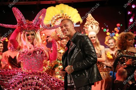 Stock Image of The Irish actress, model and former Miss World 2003, Rosanna Davison (L) and US model Jeremy Meeks (C) perform on stage in the Lambertz Monday Night event at Alter Wartesaal in Cologne, Germany, 03 February 2020. Every year the German chocolate manufacturer Aachener Printen- und Schokoladenfabrik Henry Lambertz celebrates an event where the models on the catwalk wear creations made of gingerbread, chocolate and sweets.