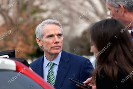 United States Senator Robert Portman (Republican of Ohio) speaks to members of the media as he departs the United States Capitol,. The impeachment trial of United States President Trump stands adjourned for the day, with a final vote on a verdict expected on Wednesday.