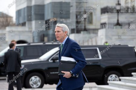United States Senator Robert Portman (Republican of Ohio) departs the United States Capitol, as the impeachment trial of United States President Trump stands adjourned for the day. The Senate is expected to vote on a final verdict on Wednesday.
