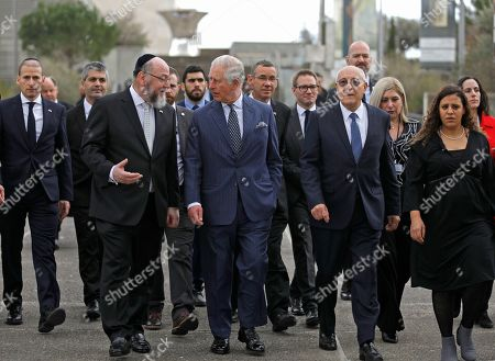 Stock Picture of Britain's Prince Charles walks alongside British Chief Rabbi Ephraim Mirvis, left, and Israel Museum Chairman Isaac Molcho during a visit to the Shrine of the Book at the Israel Museum in Jerusalem on