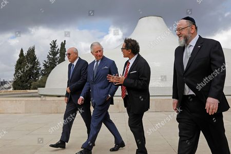From left, Israel Museum Chairman Issac Molcho, Britain's Prince Charles, Curator of the Shrine of the Book Adolfo Roitman, and British Chief Rabbi Ephraim Mirvis walk outside the 1736 Suriname reconstructed Tzedek ve-Shalom Synagogue at the Israel Museum in Jerusalem on