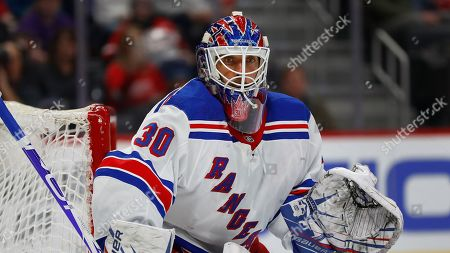 New York Rangers goaltender Henrik Lundqvist plays against the Detroit Red Wings in the second period of an NHL hockey game, in Detroit