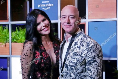 Stock Image of Jeff Bezos, Lauren Sánchez. Amazon CEO Jeff Bezos, right and his girlfriend Lauren Sanchez poses for photographs during a blue carpet event organized by Amazon Prime Video in Mumbai, India. Michael Sanchez, the brother of Jeff Bezos's girlfriend, is suing the Amazon founder for defamation, alleging that Bezos and his team falsely told reporters that he provided nude photos of Bezos to the The National Enquirer