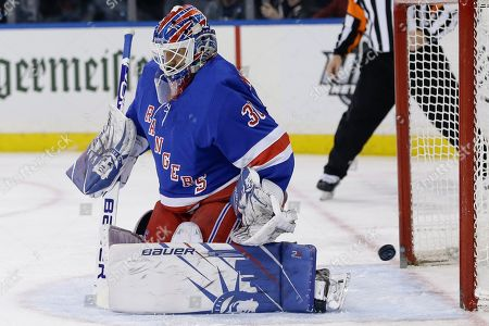 New York Rangers goaltender Henrik Lundqvist (30) reacts as the puck shot by Dallas Stars' Joe Pavelski gets past him for a goal during the first period of an NHL hockey game, in New York