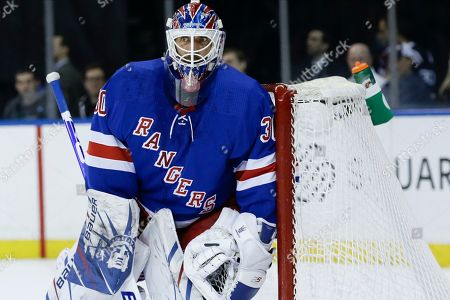 New York Rangers goaltender Henrik Lundqvist (30) protects his net during the first period of an NHL hockey game against the Dallas Stars, in New York